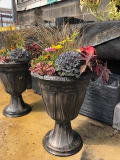 Fall container with perennial sedum and grasses